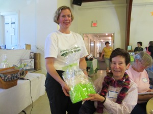 Susan presenting Sue with a door prize!