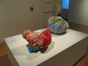 Two of Judith Scott's yarn sculptures!